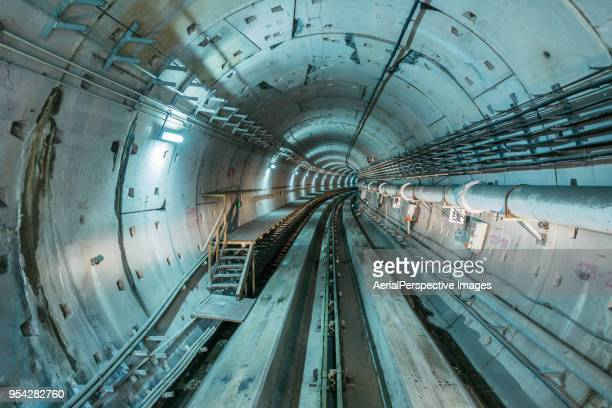 driver pov over single metro tunnel as seen from a driverless metro train - civil engineering stock photos and pictures
