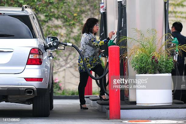 A driver pays for her gas while filling up the tank at a gas station in Monterey Park east of downtown Los Angeles on March 13 2012 in California...