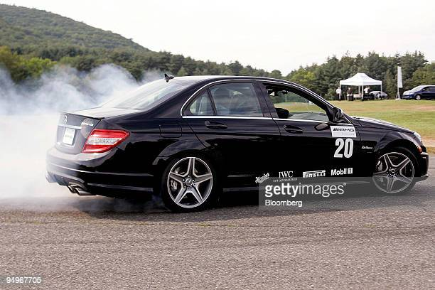 A driver peels out in a MercedesBenz C63 AMG during a MercedesBenz AMG Driving Academy event at the Lime Rock Park racetrack in Lime Rock Connecticut...