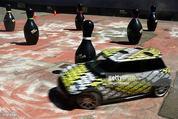 A driver plays a largerthanlife game of bowling with a Mini Cooper at Ultimo Car Park on October 13 2007 in Sydney Australia MINI launched the...