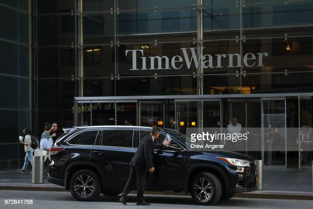 A driver polishes a car outside the Time Warner Center June 12 2018 in New York City A federal judge today said that ATT can move forward with its...