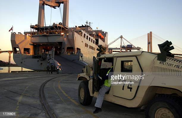 A driver prepares to load a US Army Humvee aboard the USNS Mendonca January 14 2003 at the Port of Savannah Georgia The Mendonca was being loaded...