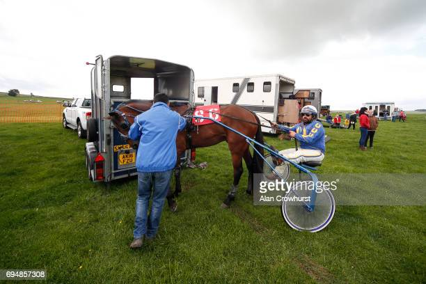 A driver prepares to take his horse to the start at Pikehall harness racing course on June 11 2017 in Matlock England