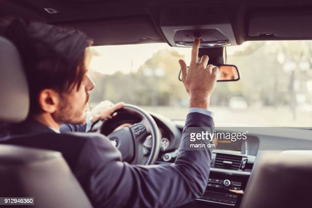 driver pressing the sos button - uber stock photos and pictures