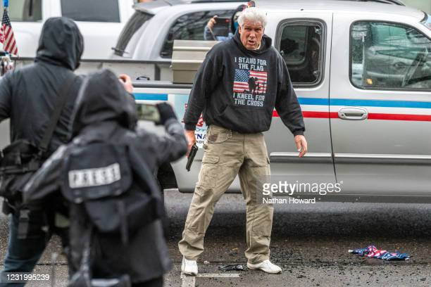 Driver pulls a handgun on protesters after they broke his trucks lights on March 28, 2021 in Salem, Oregon. The protesters clashed with occupants of...