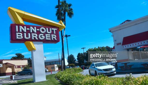 A driver pulls into the drivethru lane at an InNOut Burger restaurant in Alhambra California on August 30 2018 Califoria's Democratic Party Chairman...