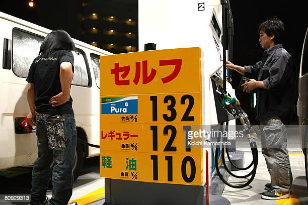 A driver put petrol in his car at a gas station on April 30 2008 in Tokyo Japan Japanese Prime Minister Yasuo Fukuda announced today that a tax of 25...