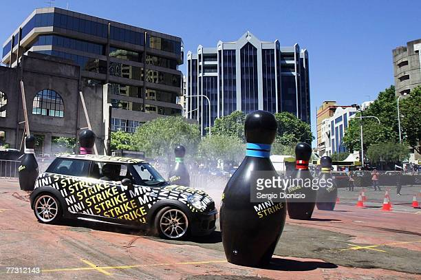 A driver races though a largerthanlife game of bowling with a Mini Cooper at Ultimo Car Park on October 13 2007 in Sydney Australia MINI launched the...