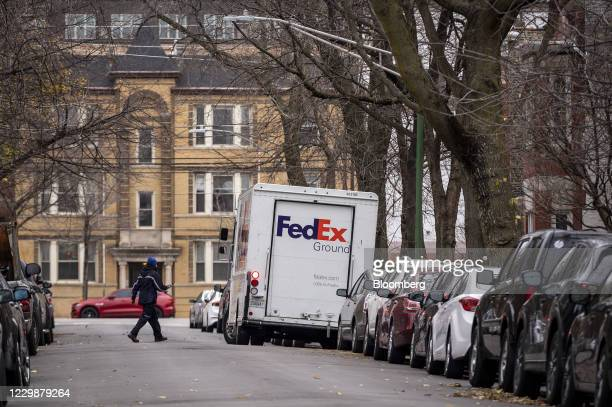 Driver returns to a FedEx Corp. Ground truck in the Lincoln Park neighborhood of Chicago, Illinois, U.S., on Monday, Nov. 30, 2020. Online shoppers...