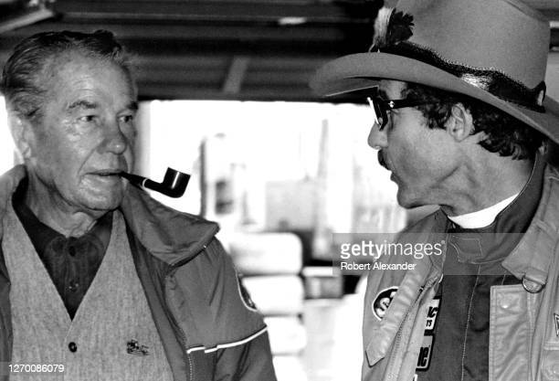 Driver Richard Petty, right, talks with his father, former NASCAR driver Lee Petty, in the speedway garage prior to the start of the 1987 Daytona 500...