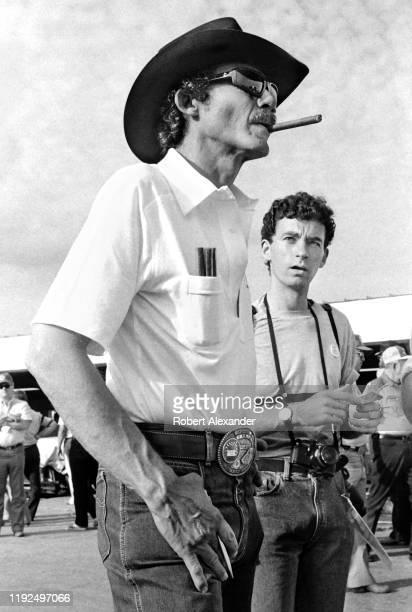 Driver Richard Petty walks in the speedway garage area prior to the start of the 1986 Daytona 500 NASCAR race at Daytona International Speedway in...