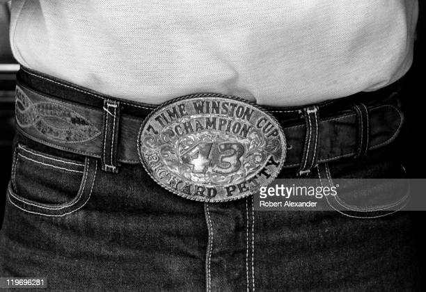 NASCAR driver Richard Petty wears a belt buckle commemorating his seven Cup championships as he walks through the Daytona International Speedway...