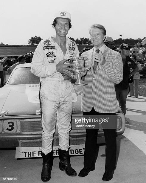 Driver Richard Richard Petty celebrates in Victory Lane with Georgia Governor Jimmy Carter after winning the Dixie 500 race on July 28 1974 at the...