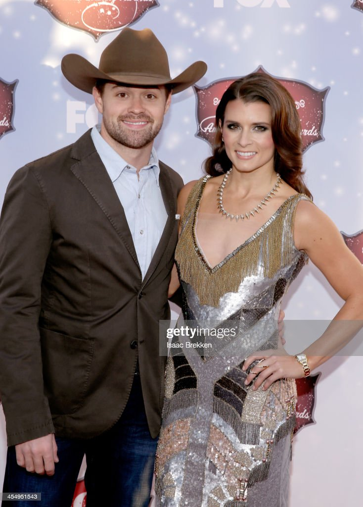 Driver Ricky Stenhouse, Jr. (L) and co-host Danica Patrick arrive at the American Country Awards 2013 at the Mandalay Bay Events Center on December 10, 2013 in Las Vegas, Nevada.