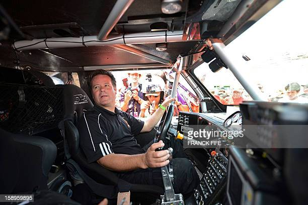 US driver Robby Gordon gestures inside his Hummer in Lima on January 4 ahead of the 2013 Dakar Rally which this year will thunder through Peru...