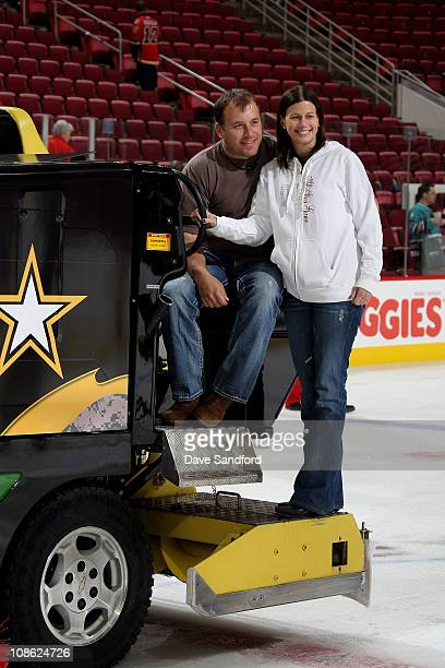 NASCAR driver Ryan Newman and his wife Krissie smile while on the ice resurfacing machine after the 58th NHL AllStar Game at the RBC Center on...