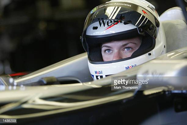 IRL driver Sarah Fisher prepares to leave the garage in the McLaren F1 car before she completing 3 laps during the FIA Formula One Grand Prix at the...