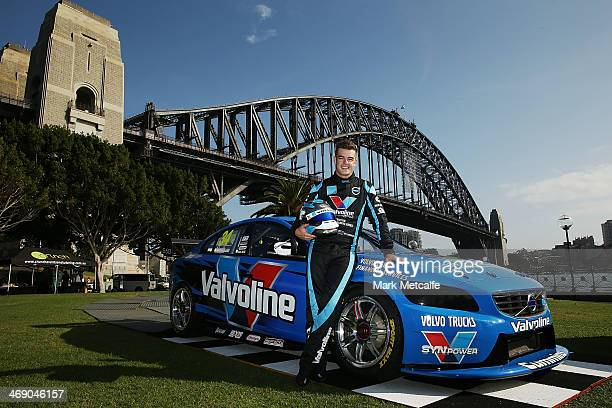 Driver Scott McLaughlin poses in front of the Volvo S60 race car and the Sydney Harbour Bridge during the Volvo Polestar Racing 2014 V8 Supercar...