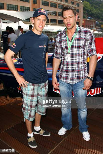 Driver Sebastian Vettel and Boxer Felix Sturm pose at the Red Bull hospitality centre during Qualifying at the Monaco Formula One Grand Prix at the...