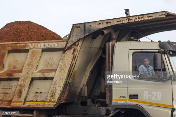 A driver sits in the cabin of a truck laden with iron ore at Krishnapatnam Port in Krishnapatnam Andhra Pradesh India on Saturday Aug 12 2017 Growth...