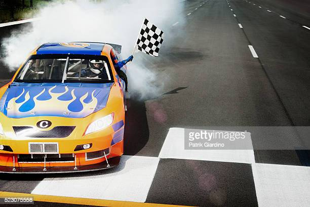 driver sitting in racecar and showing checkered flag - nascar stock pictures, royalty-free photos & images