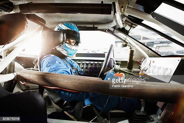 driver sitting in racecar - auto racing stock pictures, royalty-free photos & images