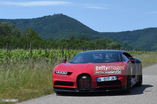 A driver steers a Bugatti Chiron near the luxury automobiles manufacturer Bugatti's headquarters in Molsheim eastern France on June 5 2019