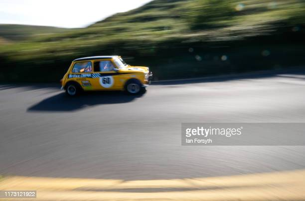 A driver steers his Mini Cooper around a corner during the Saltburn Hill Climb event on September 08 2019 in SaltburnbytheSea England Organised by...