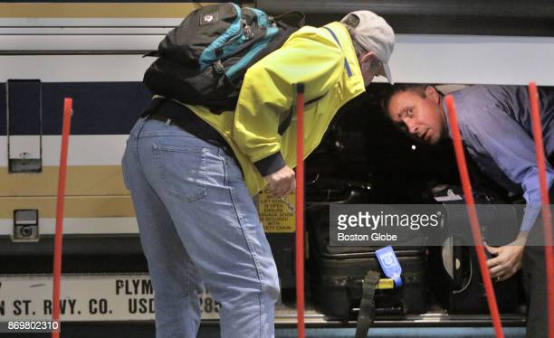 Driver Stoyan Asenov helps a passenger find his luggage after arriving at South Station in Boston on Nov 1 2017 With a shortage in the bus driver...
