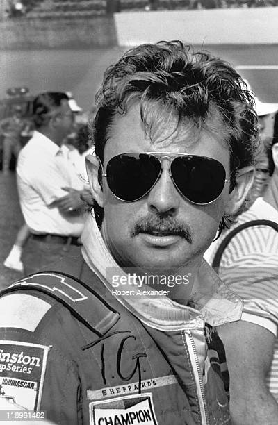 NASCAR driver Tim Richmond awaits drivers' introductions at the 1986 Firecracker 400 on July 4 1986 at the Daytona International Speedway in Daytona...