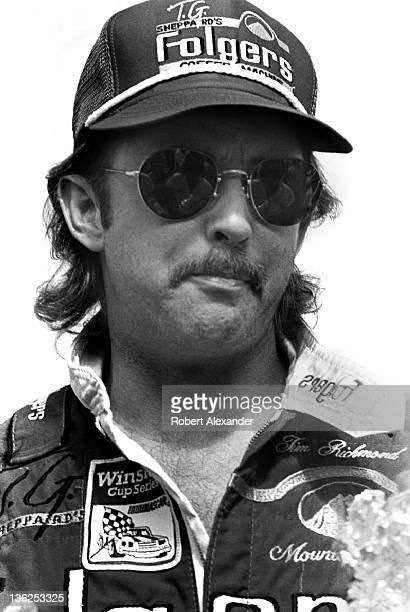 NASCAR driver Tim Richmond stands beside his race car prior to the start of the 1987 Firecracker 400 on July 4 1987 at the Daytona International...