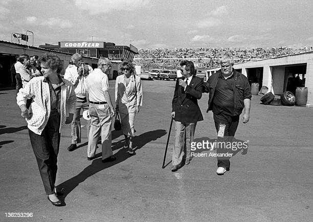 NASCAR driver Tim Richmond suffering from AIDS and walking with a cane visits the Daytona International Speedway garage area prior to the start of...