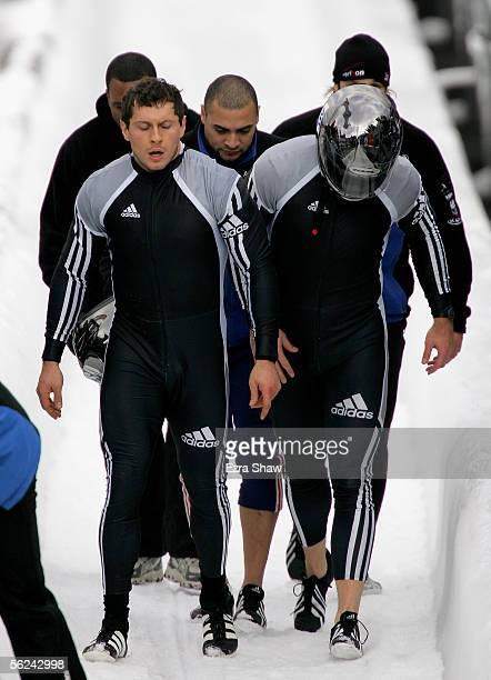 Driver Todd Hays and teammate Pavle Jovanovic walk up the track after they finished the second heat of the FIBT Men's FourMan Bobsled World Cup Race...