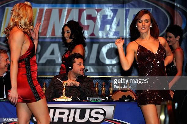Driver Tony Stewart smiles as award presenters walk around him during the The Stewies on SIRIUS NASCAR Radio during NASCAR Sprint Cup Series...