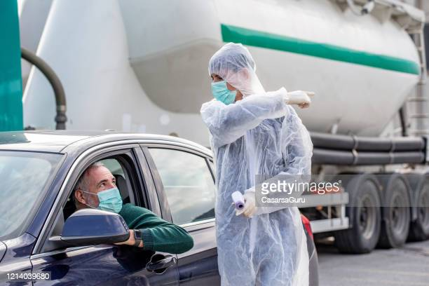 driver traveling across the border rejected after presenting high body temperature at control - infrared thermometer stock pictures, royalty-free photos & images