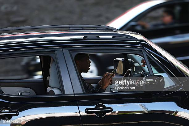 A driver uses a phone while behind the wheel of a car on April 30 2016 in New York City As accidents involving drivers using phones or other personal...