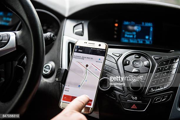 A driver uses a Samsung Electronics Co Galaxy edge smartphone displaying the Uber Technologies Inc car service taxi application to pick up a...