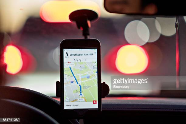 A driver uses an Uber Technologies Inc car service app on a mobile device while driving in Washington DC US on Wednesday Nov 29 2017 Uber...