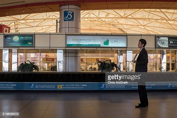 A driver waits to collect a passenger arriving at baggage claim at Sharm El Sheikh airport on March 31 2016 in Sharm El Sheikh Egypt Prior to the...