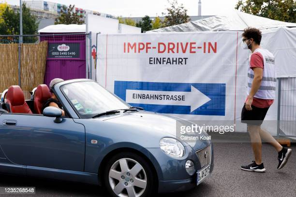 Driver waits to receive a dose of the the Moderna vaccine in a drive-in vaccination station in an IKEA car park on the third day of the...