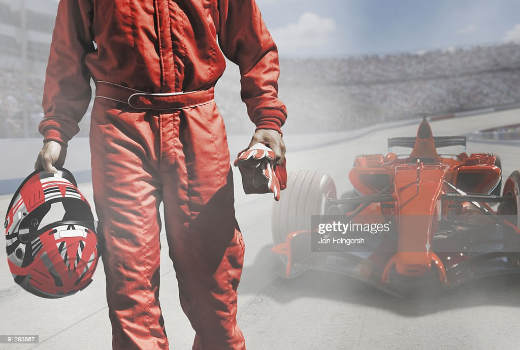 Driver walking away from Formula One race car. : Stock Photo