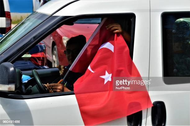 A driver waves a Turkish flag from his car during a rally in support of Meral Aksener presidential candidate and the leader of the opposition IYI...