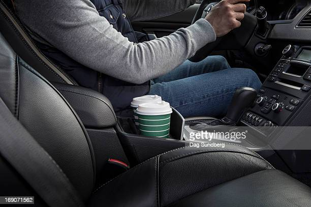 Driver with cups in a car holder