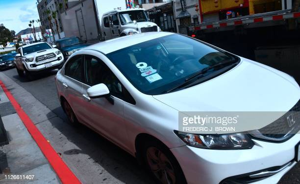 A driver with the Lyft decal on his vehicle cruises Hollywood California on February 21 2019 Lyft is preparing to list its shares on the Nasdaq...