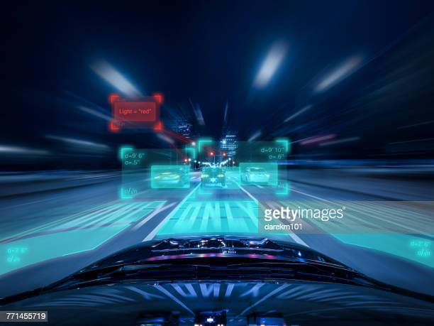 driverless car evaluating upcoming traffic - driverless transport stock pictures, royalty-free photos & images