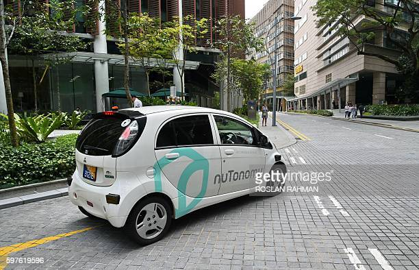 A driverless car is seen on a trial test on the road in Singapore on August 29 2016 A US compnny which launched the world's first public trials of...