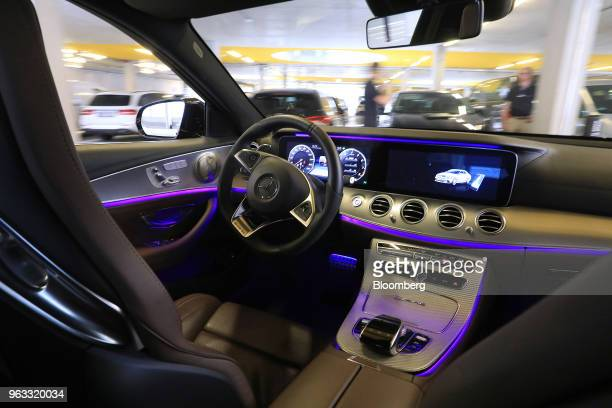 A driverless Daimler AG MercedesBenz AMG E63 S automobile maneuvers to a parking space during an Automated Valet Parking demonstration at the...