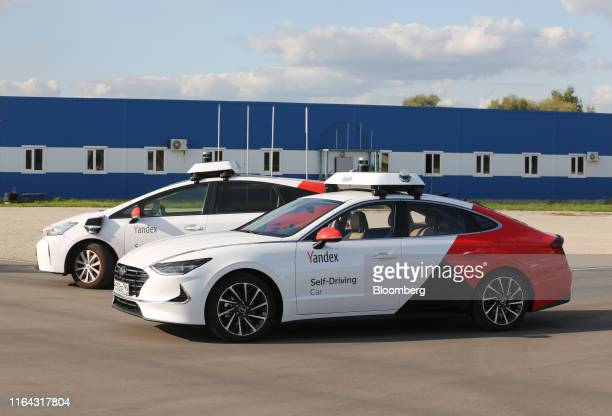Driverless Hyundai Motor Co Sonata vehicles operated by YandexTaxi part of YandexNV sit parked during a selfdriving taxi trial on a test track in...