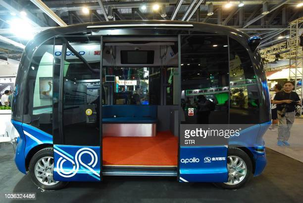 A driverless minibus by Baidu Apollo is seen during the Global Future Mobility Conference in Hangzhou in China's eastern Zhejiang province on...