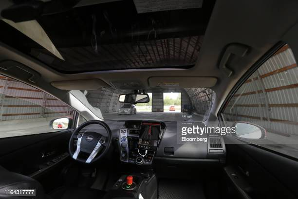 A driverless Toyota Motor Corp Prius hybrid car operated by YandexTaxi part of YandexNV takes part in tunnel simulation during a selfdriving taxi...